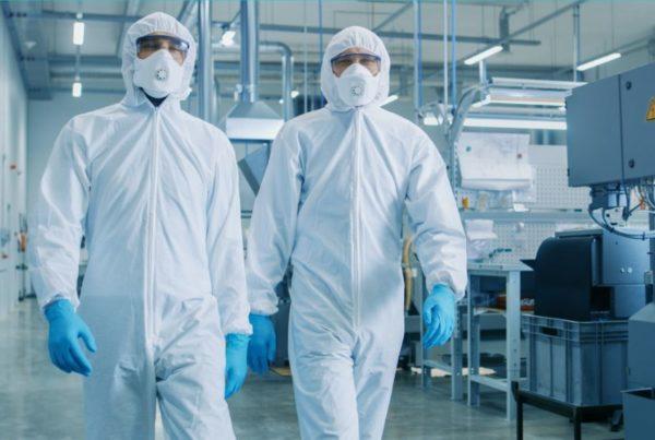two professionals in hazmat suits
